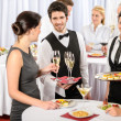 Foto de Stock  : Catering service at company event offer food