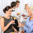 Business meeting two women celebrate champagne — Stock Photo