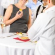 图库照片: Business woman eat dessert from catering service