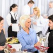 Business woman take aperitif from waiter — Stock Photo #10888625