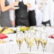 Champagne toast glasses for meeting participants — Stock Photo