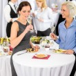 Business women drink aperitif company meeting - Stock Photo