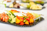 Catering table buffet vegetable salad plate — Stock Photo