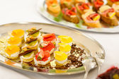 Appetizers mini desserts on catering buffet plate — Stock Photo