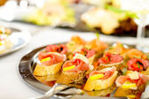 Catering canapes tray food details appetizers — Stock Photo