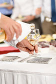 Business buffet lunch caterer serve wine appetizer — Stock Photo