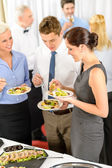 Business colleagues eat buffet appetizers — Stok fotoğraf