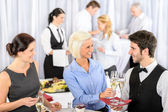 Business woman take aperitif from waiter — Stock Photo