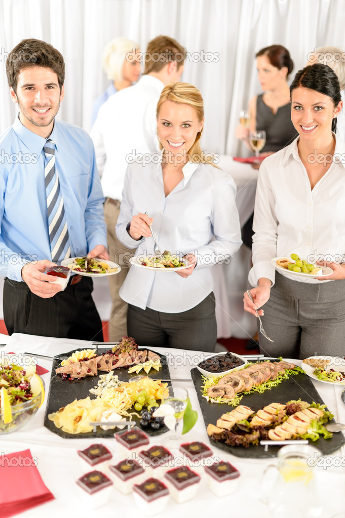 Company meeting catering smiling business eat buffet appetizers — Stock Photo #10888009