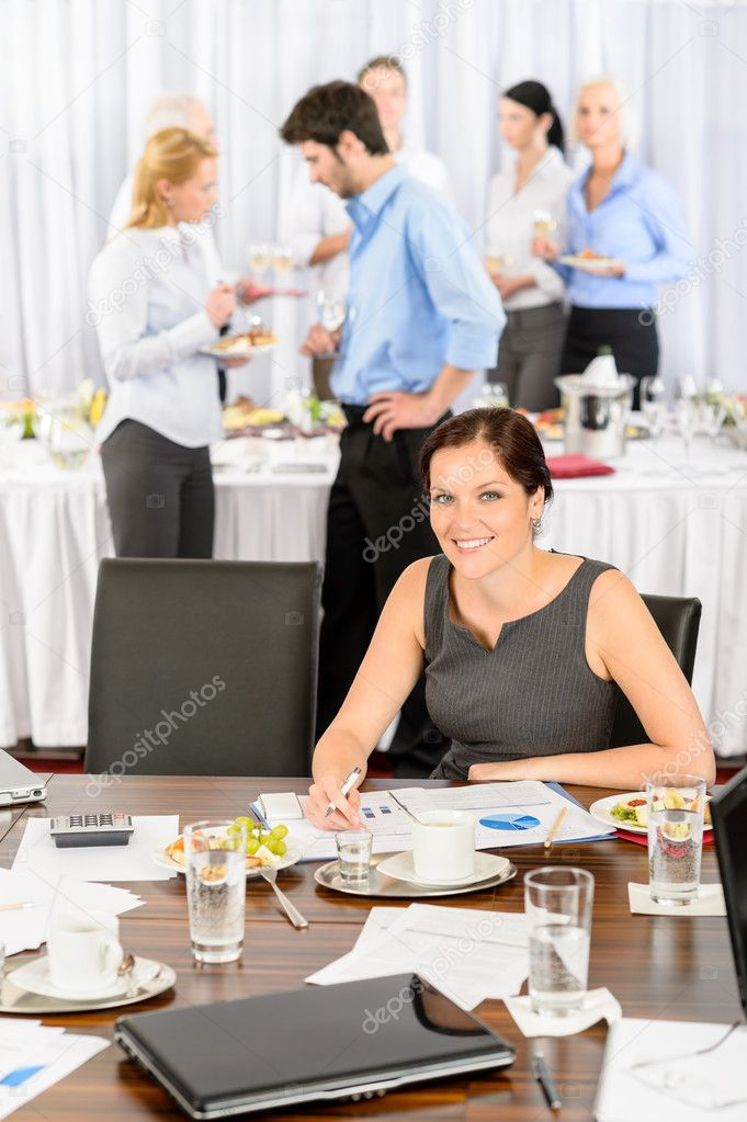 Business woman at company event work during buffet lunch  Stock Photo #10888223