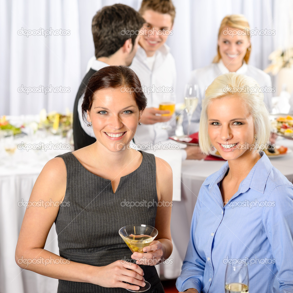 Two business woman smiling at catering buffet company meeting — Stock Photo #10888406