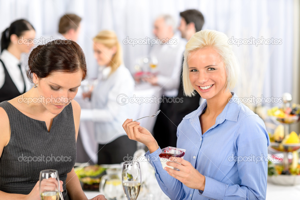 Business meeting buffet smiling woman eat dessert formal company event  Stock Photo #10888939