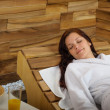 Royalty-Free Stock Photo: Relax spa woman lying on wooden chair