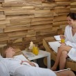 Spa treatment two women in bathrobe — Stock Photo
