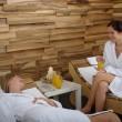 Spa treatment two women in bathrobe — Stock Photo