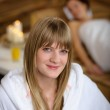 Woman in bathrobe at spa room — Stock Photo