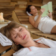 Spa room woman relax on wooden chair - Foto de Stock  