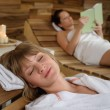 Spa room woman relax on wooden chair — Stock Photo