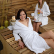Relax spa woman lying on wooden chair — Stockfoto