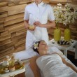Woman and masseur at luxury spa room — Stockfoto