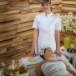 Female masseur give beauty treatment luxury spa — Stock Photo