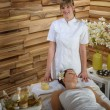 Female masseur give beauty treatment luxury spa - Stock Photo