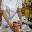 Woman head massage at luxury spa centre — Stok fotoğraf