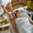 Woman shoulder massage at luxury spa centre — Stok fotoğraf