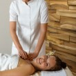 Woman and masseur at luxury spa room — Stock Photo