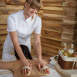 Back brush massage at luxury spa centre - Stock Photo
