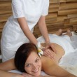 Luxury spa room woman back massage — Stock Photo #11137624