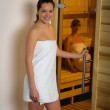 Women at sauna entering wrapped in towel — Stock Photo #11137657