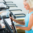 Fitness young woman on elliptical cross trainer — Stock fotografie