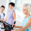 Fitness young on treadmill cardio workout — Stock Photo