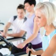Stock Photo: Fitness young on treadmill cardio workout