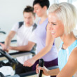 Fitness young on treadmill cardio workout - Stock Photo