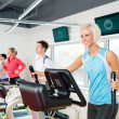 Royalty-Free Stock Photo: Young on fitness treadmill running exercise