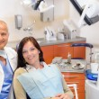 Stock Photo: Dentist and female patient at surgery office