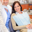 Dentist and female patient at surgery office — Stock Photo