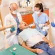 Senior man at dentist surgery have treatment — Stock Photo