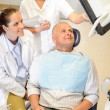 Man patient at dental consultation dentist surgery — Stock Photo