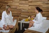 Spa treatment two woman in bathrobe — Stock Photo