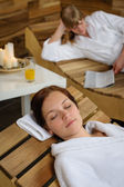 Spa room woman relax on wooden chair — Stockfoto