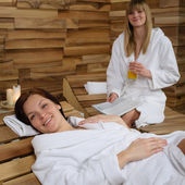 Smiling woman at spa lying down — Stock Photo