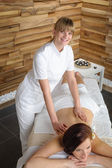 Luxury spa room masseur woman back massage — Stock Photo