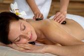 Hot stone massage woman enjoy spa treatment — Stock fotografie