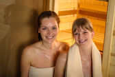 Happy women leaving sauna at wellness center — Stock Photo