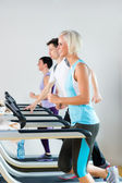Running on treadmill young fitness center — Stock Photo