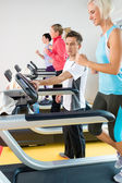 Young fitness instructor woman running at gym — Stock Photo