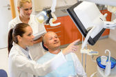 Man patient at dental consultation dentist surgery — Stockfoto